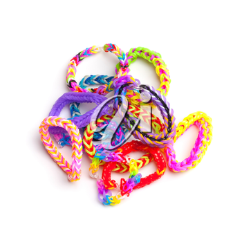 Group of colorful rubber band bracelets isolated on white, trendy teenagers fashion accessories
