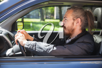 Asian man as a driver of modern Japanese suv, profile portrait in open car window