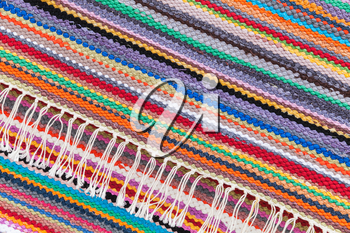 Colorful abstract patchwork rug with striped pattern, background photo texture