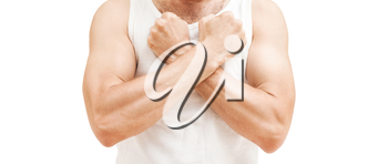 Young sporty Caucasian man in white shirt holds his fists near chest, protest gesture. Studio shot isolated on white