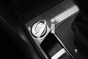 Modern luxury car interior detail, engine start stop button
