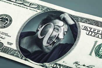Frustrated angry man on the dollar banknote crying