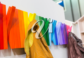 Multicolored wooden hanger with jackets