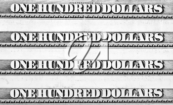 Row of one hundred dollars banknotes. Close-up view