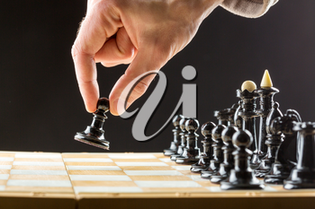 Close up of man's hand playing chess