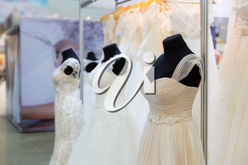 Wedding dresses on mannequin in the shop