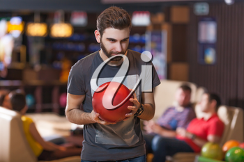 Portrait of a bearded man with bowling ball