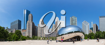 Chicago, Illinois, USA - June 14, 2016. Cloud Gate sculpture in Millenium park. One of the most unique and interesting sculptures. Author Anish Kapoor. Panorama cityscape.
