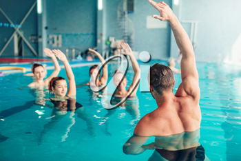 Aqua aerobics in water sport center, indoor swimming pool, recreational leisure