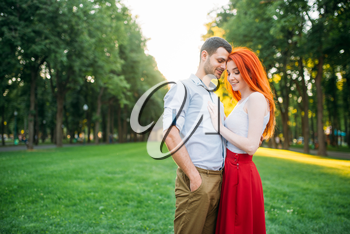 Romantic date, love couple hugs together, meeting in summer park. Attractive woman and young man leisure outdoors