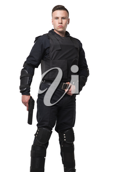 Armed special force soldier in black uniform and body armor, white background. Police officer, law guard