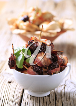 Prunes wrapped  in rashers of bacon - detail