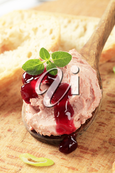 Liver pate on a wooden spoon and bread