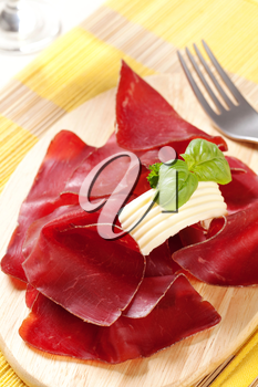 Thin slices of dry cured ham and butter