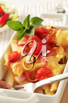 Pasta with ham and cheese topped with crushed tomatoes