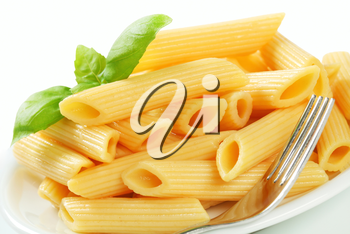 Portion of cooked penne pasta