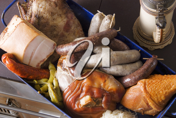 Variety of meat products in a baking pan