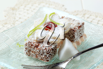 Chocolate dipped mini cakes coated in desiccated coconut