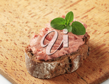 Slice of brown bread and smooth liver pate