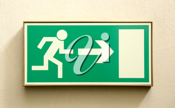 Emergency exit sign on a wall - closeup