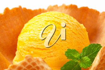 Scoop of yellow ice cream in a wafer bowl