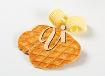 Thin waffle crisps and curls of fresh butter