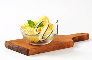 Curls of fresh butter in glass bowl