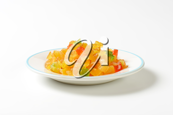 plate of candied fruit on white background