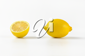 one and half fresh lemon on white background