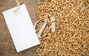 wheat grain and tag price on wood