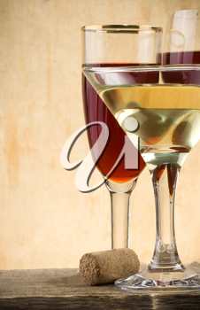 glass of wine on wood background