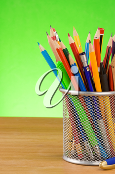 holder basket and office supplies  on wood background