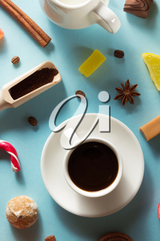 cup of coffee at blue paper background