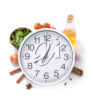 wall clock and food herbs and spices isolated on white background