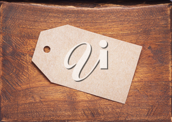 paper tag price at aged wooden background texture surface