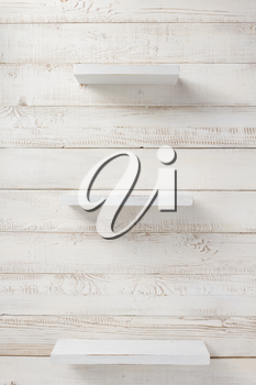 set of wooden shelf on white wall background texture