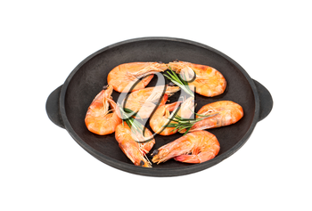 Fried shrimp with rosemary in a portioned frying pan isolated on white background