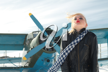 sexy young girl next to the pilot vintage aircraft