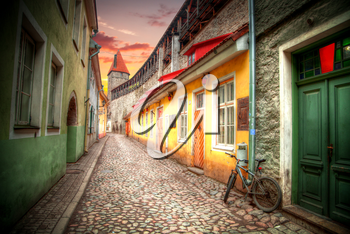 bike on the street. Old streets of European cities. Cozy cottages. Tallinn the capital of Estonia on the Baltic Sea.