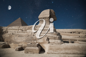 Guardian Sphinx guarding the tombs of the pharaohs in Giza. Cairo, Egypt. night shining moon and stars.
