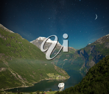 scenic landscapes of the northern Norwegian fjords. night shining moon and stars.