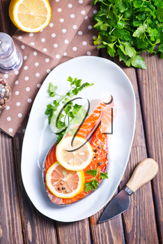 salmon with lemon and pepper on plate