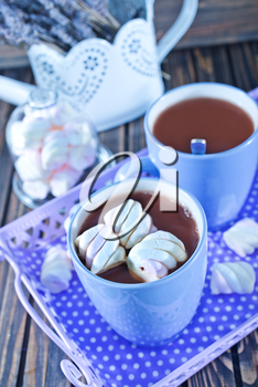 cocoa drink with marshmallows on a table