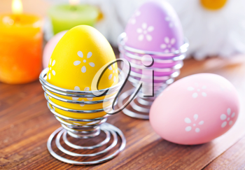 easter eggs on the wooden table, color eggs