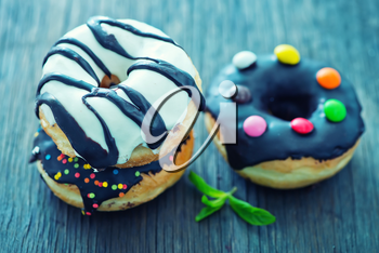 sweet donuts on the wooden background, fresh donuts