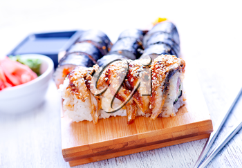 fresh sushi on tray and on a table
