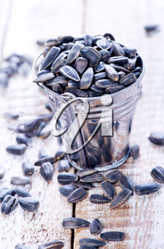 sunflower seed on the wooden table, dry sunflower seed