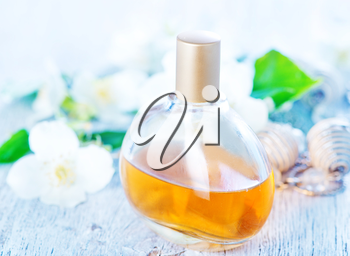 perfume in bottle and on atable