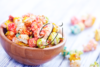 color popcorn in bowls and on a table