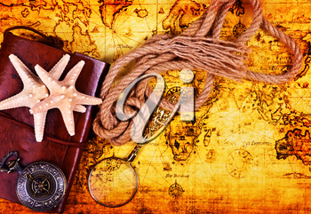 travel background, old notebook, loupe and compass on the map